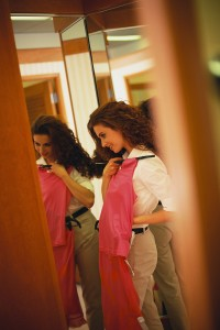 Woman Checking Outfit in Mirror